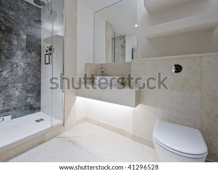 modern luxury bathroom with black and white marble - stock photo