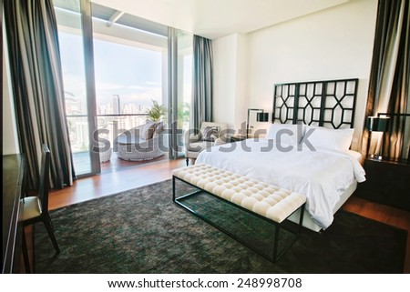 Modern luxury bedroom with a large balcony - stock photo