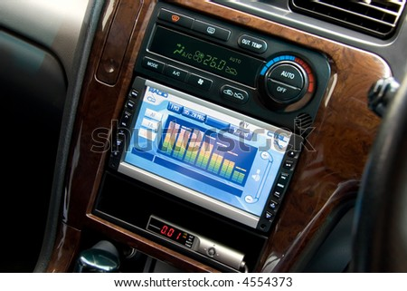 Modern luxury car interior, tv/dvd/audio system with monitor and climat control view. - stock photo