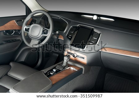 modern luxury car interior, wood panels, perforated leather seats
