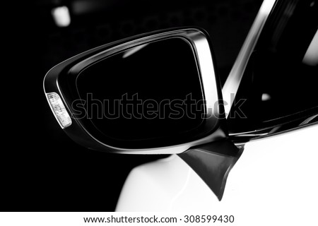 Modern luxury car wing mirror close-up. Expensive, sports auto. Black and white - stock photo