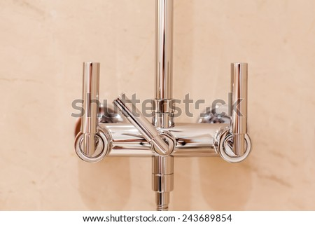 Modern luxury chrome shower tap. Front closeup view - stock photo