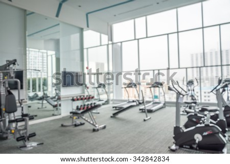 Modern luxury fitness center city view abstract blur background - stock photo
