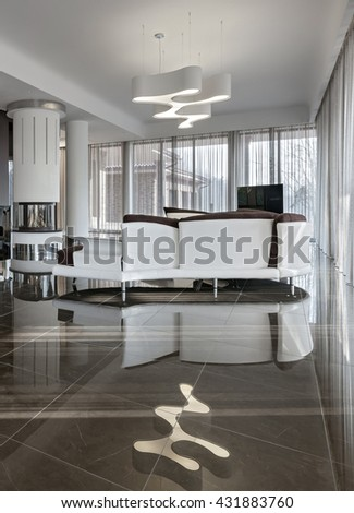 Modern luxury interior in minimalistic style: new living room with fireplace in daylight - stock photo
