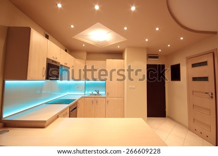 Modern luxury kitchen with blue LED lighting - stock photo