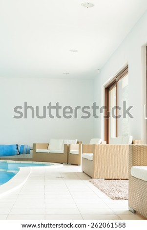 Modern luxury room with swimming pool - stock photo
