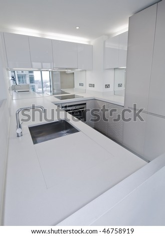 modern luxury white kitchen with built in electric appliances - stock photo