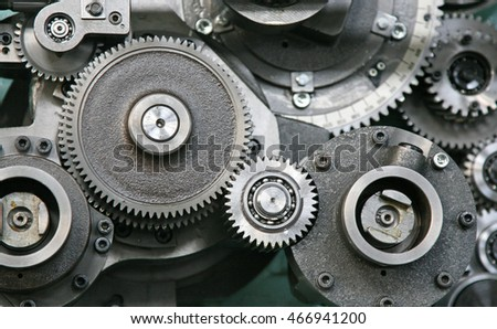 Modern machinery: gear, metal cogwheels, nuts and bolts.
