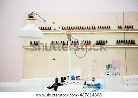 Modern manicure salon interior with table lamp.