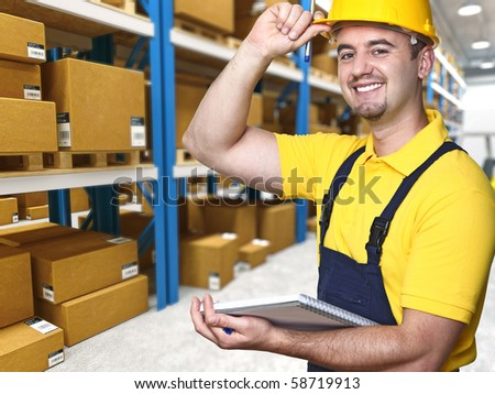 modern manual worker with laptop in warehouse - stock photo