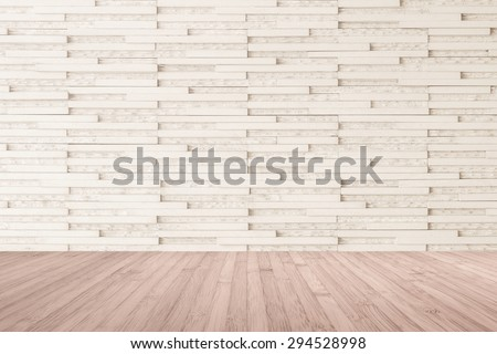 Modern marble tile wall pattern background in light cream beige color with wooden floor in red brown tone : Horizontal marble rock stone tiled pattern texture backdrop with wood flooring            - stock photo