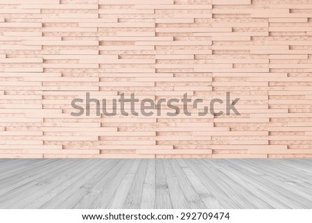 Modern marble tile wall pattern  background in light red brown color with wooden floor in grey tone : Horizontal marble rock stone tiled pattern texture detailed backdrop with wood flooring           - stock photo