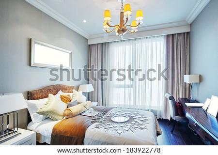Modern master bedroom interior - stock photo