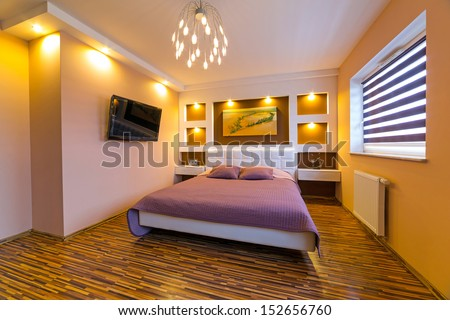Modern master bedroom interior with picture of shipwreck on the wall (photo is coming from my gallery) - stock photo