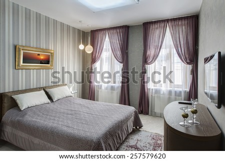 Modern master bedroom interior with picture of sunset on the wall (photo coming from my gallery) - stock photo