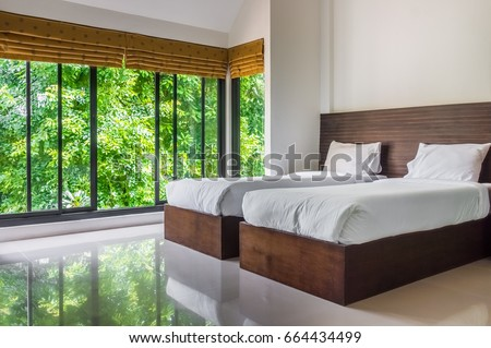 modern twin bed. Modern Master Bedroom With Twin Beds And Wide Glass Windows. The Design To Give Scenic Bed 1
