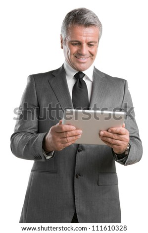Modern mature businessman looking and working on digital tablet isolated on white background - stock photo