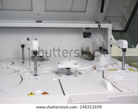 modern medical equipment for centrifuge blood and urine testing - stock photo