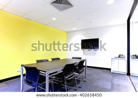 Modern meeting room or office with white and yellow walls on the carpet floor