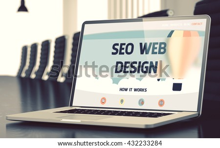 Modern Meeting Room with Laptop on Foreground Showing Landing Page with Text SEO Web Design. Closeup View. Blurred Image with Selective focus. 3D Illustration. - stock photo