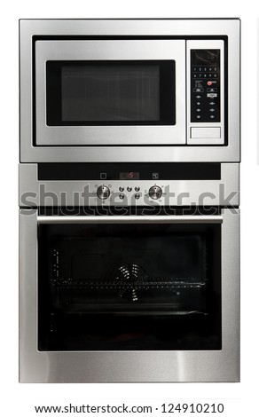 Modern metallic oven and microwave isolated on white - stock photo