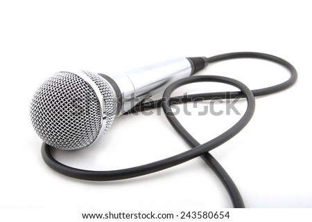 Modern microphone on a white background - stock photo