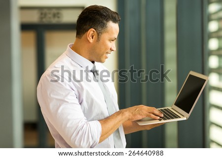 modern middle aged business man looking at computer screen - stock photo