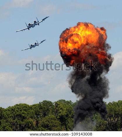 Modern military jetfighters performing target bomb raid - stock photo