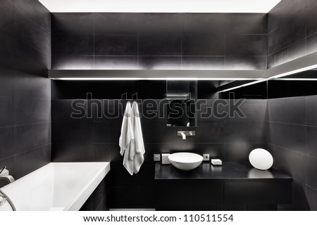 Modern minimalism style bathroom interior in black and white tones - stock photo