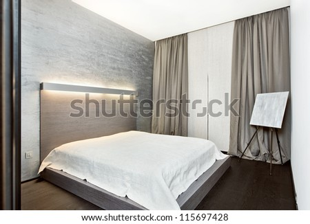 Modern minimalism style bedroom interior in monochrome tones - stock photo
