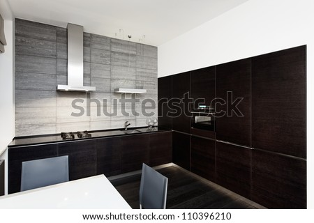 Modern minimalism style kitchen interior in monochrome tones - stock photo