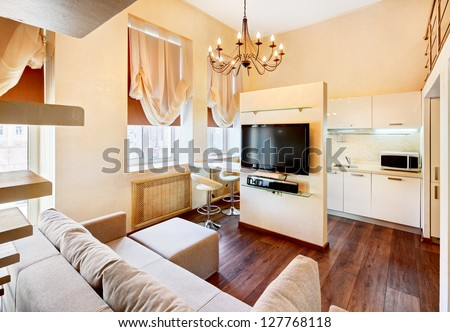 Modern minimalism style living-room interior with lcd TV in pastel tones - stock photo