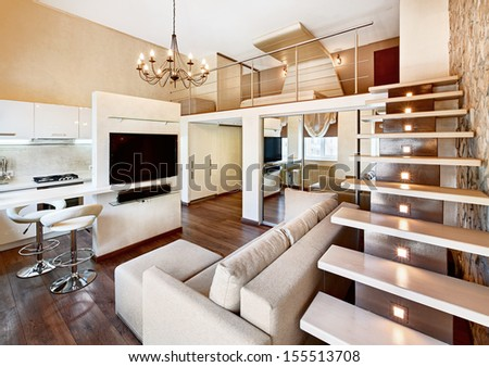 Modern minimalism style two-high drawing-room interior with staircase in beige tones - stock photo