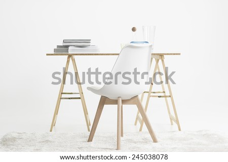 Modern minimalist desk or worktable on two trestles with a stack of magazines and books on top with a modular chair on a shaggy white carpet in a white room - stock photo