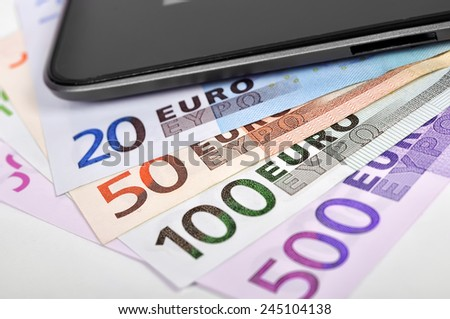 Modern mobile phone and euro banknotes, close up - stock photo