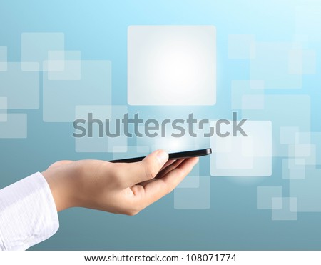 Modern mobile phone in a hand - stock photo