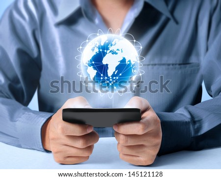 Modern mobile phone in hand - stock photo