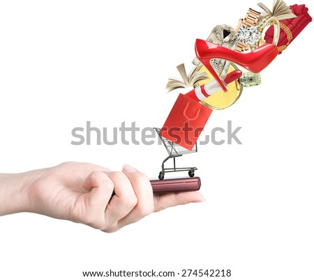 Modern mobile phone in the hand with lots of goods isolated on white (e-shopping and sale concept) - stock photo