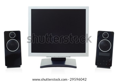 Modern Monitor and speakers. - stock photo