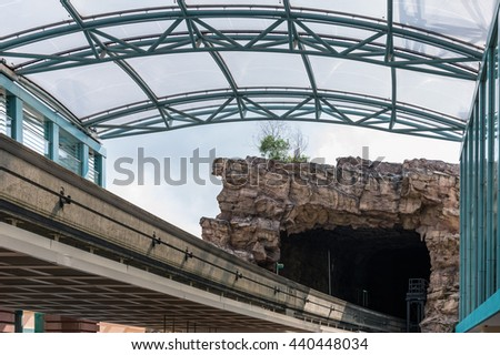 Modern monorail track from urban station to the artificial  tunnel. - stock photo