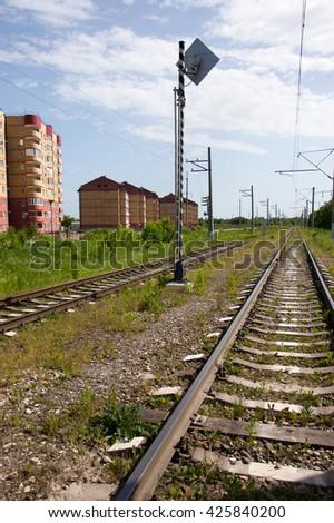 modern multi-storey buildings along railroad tracks - stock photo