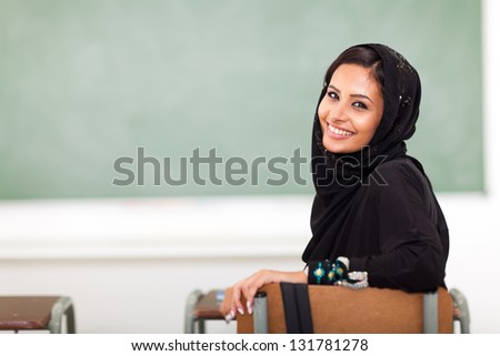 modern Muslim college girl in classroom - stock photo