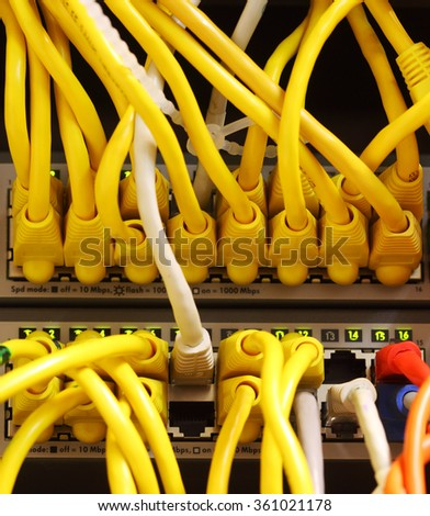 Modern network switch with cables - stock photo