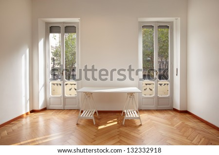 Modern new apartment room with desk - stock photo
