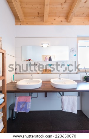 modern new bath room with two basins in timber house - stock photo