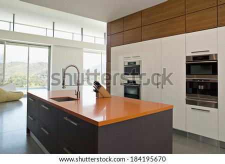 Modern new kitchen with expensive appliances - stock photo