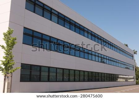 Modern new office building under a blue sky - stock photo