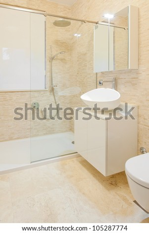 Modern new shower room with stone tiles - stock photo