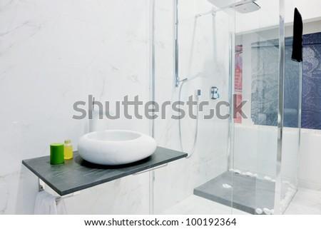 Modern new small bathroom interior with bath tub. - stock photo