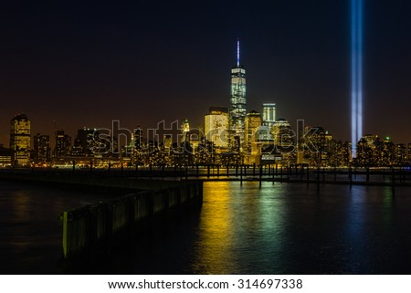 Modern New York night skyline, including the Freedom Tower - stock photo